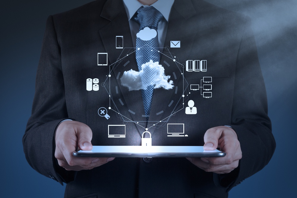 Businessman hand working with a Cloud Computing diagram on the new computer interface as concept.jpeg