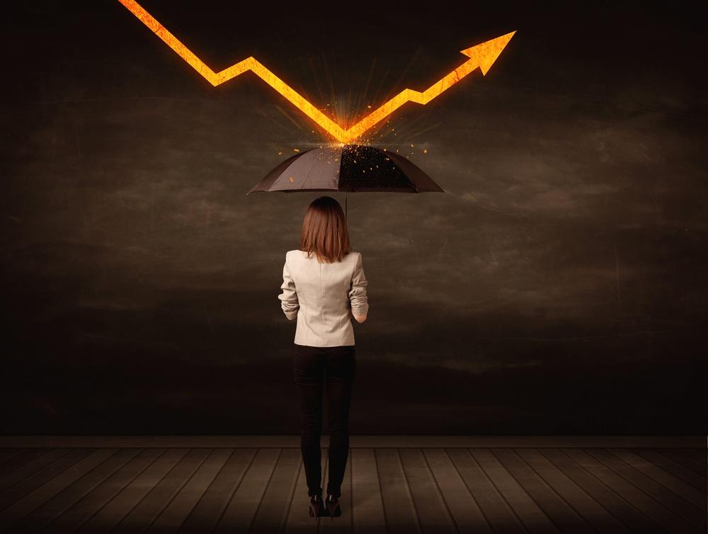 Businesswoman standing with umbrella keeping orange arrow concept on background.jpeg