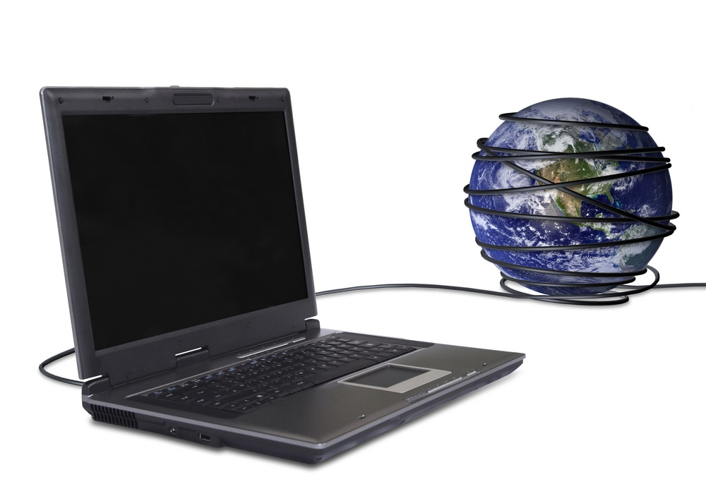 business laptop connected to the globe, online communications.jpeg